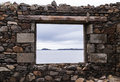 Sea view from a stone window of an old ruin near the ocean in isle harris scotland uk Stock Image