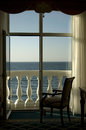 Sea view through the window and balcony door at the luxury hotel Royalty Free Stock Image