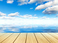 Sea water, blue sky, clouds, wooden plank table or pier Royalty Free Stock Photo