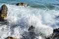 Sea wave is broken about stones. Royalty Free Stock Photo