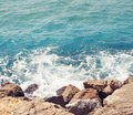 Sea, wave with foam and rocks, abstract travel photo Royalty Free Stock Photo