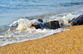 Sea wave washes over stones on the beach Royalty Free Stock Photo