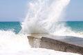 Sea waves breaking on a breakwater Royalty Free Stock Photo