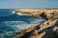 Sea waves breaking on rocky coast. Royalty Free Stock Photo