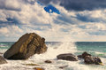Sea waves rolling on stones Royalty Free Stock Photo