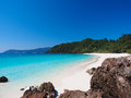 Sea and white sand beach with clear blue sky Royalty Free Stock Photo