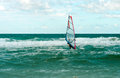 Sea windsurfing sport sailing water active leisure windsurfer training on waves summer day Stock Image