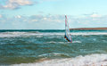 Sea windsurfing sport sailing water active leisure windsurfer training on waves summer day Royalty Free Stock Photo