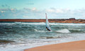 Sea windsurfing sport sailing water active leisure windsurfer training on waves summer day Stock Photo