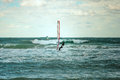 Sea windsurfing sport sailing water active leisure windsurfer training on waves summer day Royalty Free Stock Photos