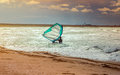 Sea windsurfing sport sailing water active leisure windsurfer training on waves summer day lifestyle concept Stock Image