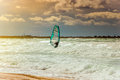 Sea windsurfing sport sailing water active leisure windsurfer training on waves summer day lifestyle concept Stock Photos