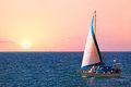 In the sea yacht sailing at sunrise Royalty Free Stock Photo
