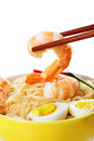 Seaafood in chopstick a close up chines noodle plate with shrimps and eggs Stock Images