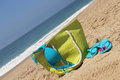 Seacoast, green beach bag and blue swimsuit Stock Photos