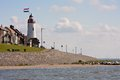 Seacoast with lighthouse of Urk, the Netherlands Royalty Free Stock Photos
