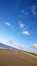 Seacoast sand beach sunny day at sea happy fisherman Stock Image
