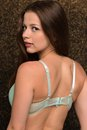 Seafoam lingerie petite young brunette in green Royalty Free Stock Photo