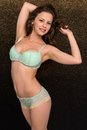 Seafoam lingerie petite young brunette in green Stock Photos