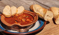 Seafood cioppino with French bread Royalty Free Stock Photo