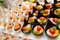 Seafood entree platter a full of ceramic bowls of appetizers Stock Photography