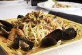 Seafood fra diavolo with linguine a colorful platter holds over fresh littleneck clams mussels shrimp and squid are piled over the Stock Image
