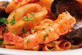 Seafood mixed saute with shrimps mussels and squids detailed macro shot Stock Photo