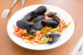 Seafood mussels ready to eat on a plate Royalty Free Stock Photos