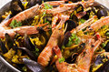 Seafood paella as closeup in a pan Royalty Free Stock Photos