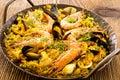 Seafood paella as closeup in a wrought iron pan Stock Photo