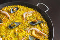 Seafood paella with shrimp clams calamari and mussels Stock Photo