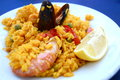 Seafood paella a traditional spanish dish with rice vegetables and meat Stock Images