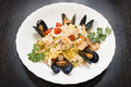 Seafood with pasta delicious on white plate Royalty Free Stock Images