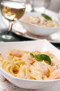 Seafood pasta prepared shrimp with linguine noodles and creamy garlic sauce on top green basil spring selective focus Royalty Free Stock Image