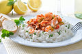 Seafood ragout with basmati rice and baguette white wine and lemons in the background Stock Photos