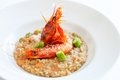 Seafood risotto with king prawns close up of dish red and asparagus Royalty Free Stock Photography