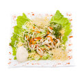 Seafood salad with squid and fresh vegetable, isolated on white Royalty Free Stock Photo