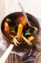 Seafood soup in casserole as closeup a Royalty Free Stock Image