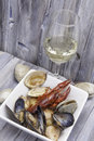 Seafood stew with wine dish of a glass of white Stock Photos