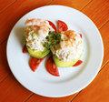 Seafood stuffed avocado Royalty Free Stock Image