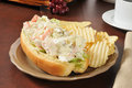 Seafood submarine sandwich a crab and served in an open faced bun Stock Image