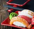 Seafood sushi and chopsticks japanese on a red plate Royalty Free Stock Image