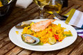 Seafoof paella seafood traditional spanish dish served in plate Royalty Free Stock Photo