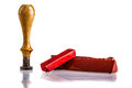 Sealing wax red sticks a wooden seal and an envelope isolated over a white background Royalty Free Stock Photo