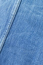 Seam on blue jeans background. Royalty Free Stock Photo