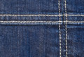 Seam on denim fabric with a in the background Royalty Free Stock Photo