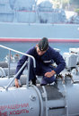 Seaman on the frigate sevastopol crimea ukraine august performs maintenance of torpedo tube russian pytlivy built in Royalty Free Stock Photo