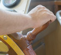 Seaman steering ship wheel by right hand Royalty Free Stock Photo