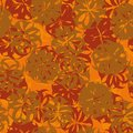 Seamless abstract floral vector pattern in rust, orange and red colors