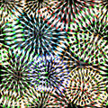 Seamless abstract multicolored pattern with fireworks on a dark background Stock Images